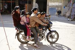 stock image of  six people on one motorcycle, dangerous transport behavior