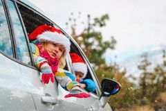 stock image of  christmas car travel- happy kids travel in winter