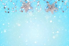 stock image of  christmas composition from christmas tree toys. white decor on a blue background. copy space, flat lay, top view.