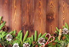 stock image of  christmas and happy new year dark brown background. top view, copy space, wooden rustic table, fir branches