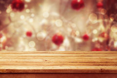 stock image of  christmas holiday background with empty wooden deck table over winter bokeh. ready for product montage