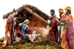 stock image of  christmas nativity scene with holy family in the hut and the three wise men, on white background