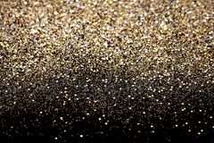 stock image of  christmas new year black and gold glitter background. holiday abstract texture fabric