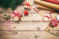 stock image of  christmas gift boxes wrapping on wooden background, copy space, top view