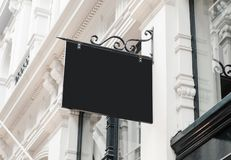 stock image of  classic style blank hanging company wall signboard mockup