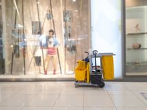 stock image of  cleaning tools cart wait for cleaner.bucket and set of cleaning equipment in the department store. janitor service janitorial for
