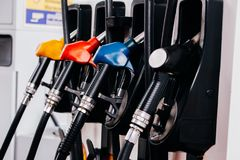 stock image of  close up of petroleum gasoline station service - oil refueling and refilling for car transportation concept.