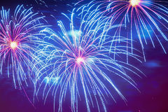 stock image of  close-up of vivid blue fireworks with sparks. explosive pyrotechnic devices for aesthetic and entertainment purposes