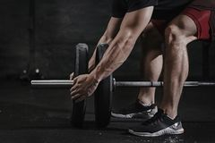 stock image of  closeup of athlete preparing for lifting weight at crossfit gym. barbell magnesia protection. practicing functional training p