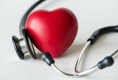 stock image of  closeup of heart and a stethoscope cardiovascular checkup concept