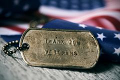 stock image of  text thank you veterans in a dog tag
