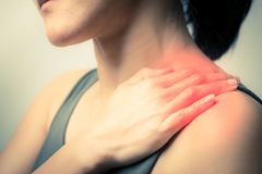 stock image of  closeup women neck and shoulder pain/injury with red highlights on pain area with white background, healthcare and medical concept