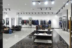 stock image of  clothing shop interior fashion store