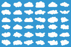 stock image of  cloud icons on blue background. 36 different clouds. cloudscape. clouds.