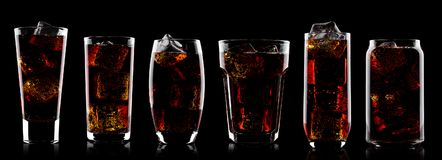stock image of  cola soda drink glasses with ice cubes on black