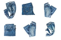 stock image of  collection of folded jeans isolated on white background