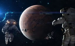 stock image of  colonization of mars. astronauts, space stations in mars orbit. science fiction art. elements of the image were furnished by nasa