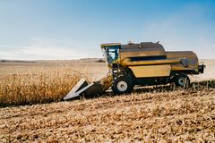stock image of  combine harvester working in the fields. agriculture farmer working with machinery