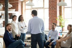 stock image of  company executive manager talking with company members during briefing