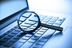 stock image of  computer magnifying glass security information data