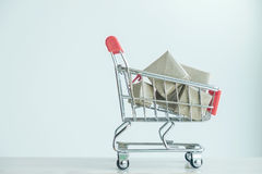 stock image of  concept of buy shopping, red shopping cart full of gifts box