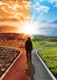 stock image of  concept responsibility environmental impact climate change and global warming with silhouette man who chooses walking on a paved j