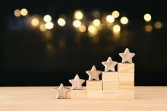 stock image of  concept image of setting a five star goal. increase rating or ranking, evaluation and classification idea.