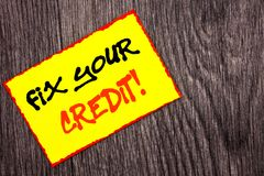 stock image of  conceptual hand writing text showing fix your credit. concept meaning bad score rating avice fix improvement repair written on yel