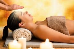 stock image of  conceptual image of woman having reiki therapy.