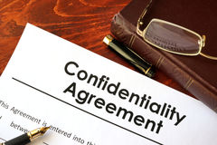 stock image of  confidentiality agreement form on a table.