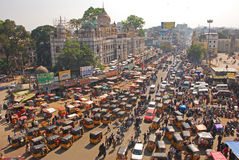 stock image of  congested traffic, busy & overcrowded road with public transport