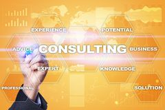 stock image of  consulting business concept. text and icons on virtual screen.