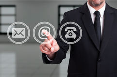 stock image of  contact our company concept with businessman pressing email