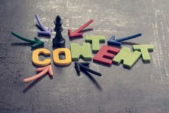 stock image of  content is king in advertising and communication concept, colorful arrows pointing to the word content at the center with chess k