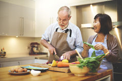 stock image of  couple cooking together enjoyment concept