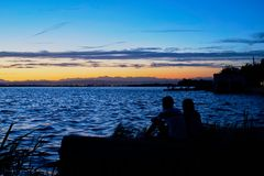 stock image of  couple in love contemplate the sunset in the albufera of valencia