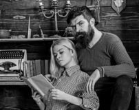 stock image of  couple in love reading poetry in warm atmosphere. lady and man with beard on dreamy faces with book, reading romantic