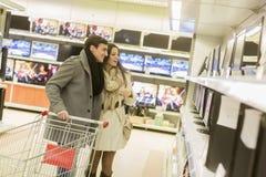 stock image of  couple shopping electronics