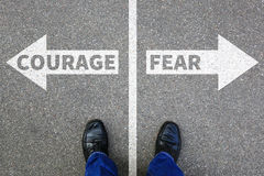 stock image of  courage and fear risk safety future strength strong business con