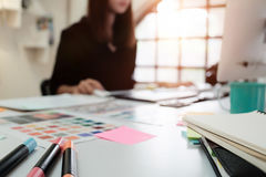stock image of  creative table and woman graphic design blur