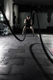 stock image of  crossfit battling ropes at gym workout exercise. crossfit