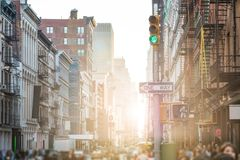 stock image of  crowded streets and sidewalks of soho in new york city