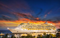 stock image of  cruise ship in port on sunset.