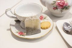 stock image of  cup of tea and biscuit