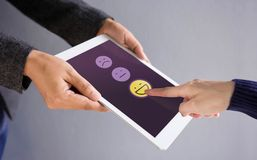 stock image of  customer experience concept. happy client pressing a smiley face