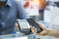 stock image of  customer use smartphone payment for goods and services