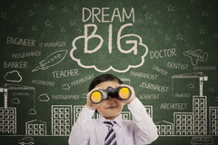 stock image of  cute boy with text of dream big