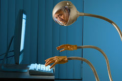 stock image of  cyber robot internet hacking thief