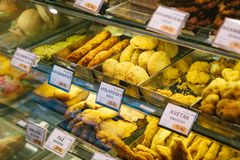 stock image of  different kinds of desserts in the store in prague. czech desserts. cakes, pastries and pies are on sale on the display