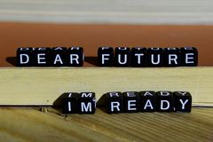 stock image of  dear future i`m ready on wooden blocks. motivation and inspiration concept